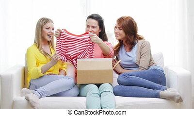 smiling teenage girls opening cardboard box - transportation...