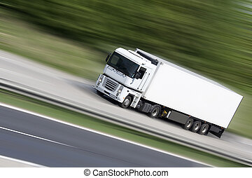 Transportation - White truck on highway (blur background) -...