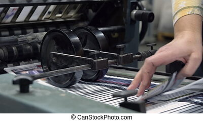 transporter in printing house - close up conveyor belt in a...