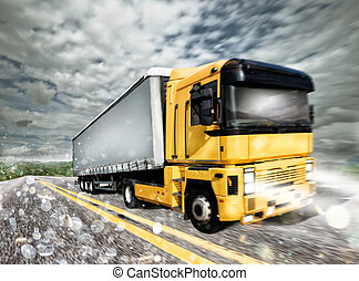 Transporter truck on a highway during storm
