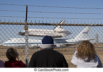 Endeavor attached to the top of a 747 airliner being transported back to NASA in Florida