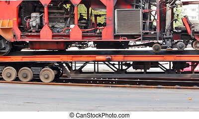 Transporting the ballast tamper by rail road