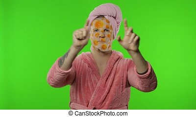 Transsexual man in bathrobe with face mask showing love ...