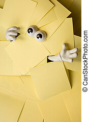 Trapped beneath paper work - Hands reach out and eyes peer...
