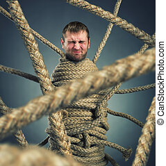 Trapped man - Businessman trapped in rope web