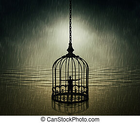 trapped - Man standing closed in a bird cage with wide...
