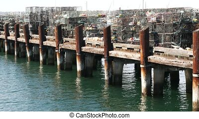 Traps, ropes and cages on pier, commercial dock, fishing ...