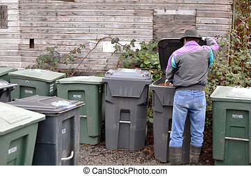 Trash and Recycle - Man dumping trash and recycle into big...