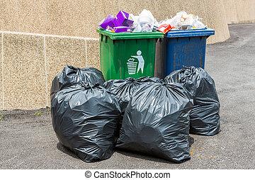 Trash bin and black garbage bag - Close up Trash bin and...
