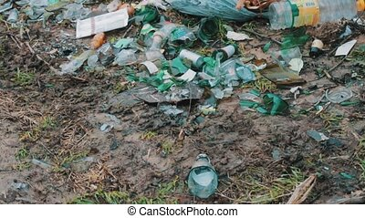 Trash, broken bottles on the dump