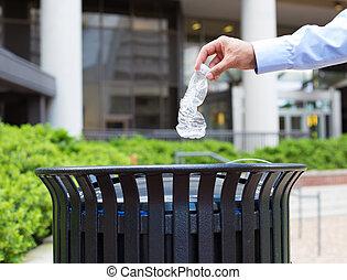 Trash recycling - Closeup portrait, hand throwing plastic ...