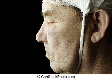 trauma - man with head bandage, selective focus on eye, ...