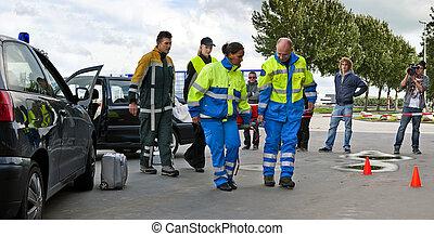 Trauma Team - Trauma team in action at the scene of a car...