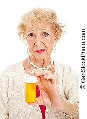 traurige , ältere frau, mit, pillen