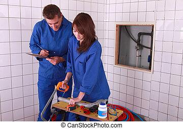 travail, plombiers, équipe