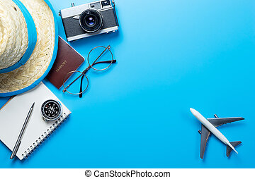 travel accessories on Blue background copy space