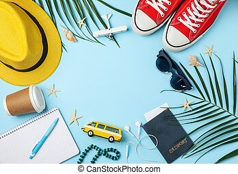 Travel accessories on blue background, top view. Travel blogger