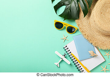 Travel accessories on mint background, top view. Travel blogger