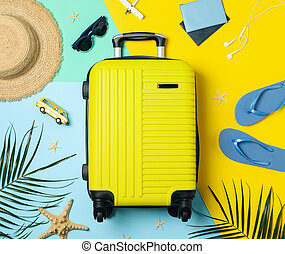 Travel accessories on two tone background, top view. Travel blogger