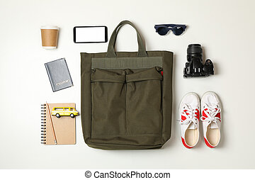Travel accessories on white background, top view