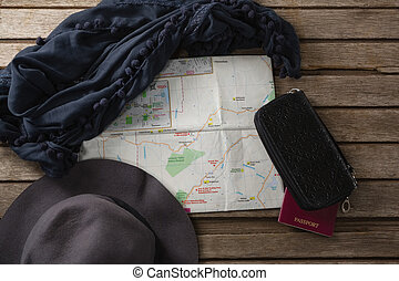 Travel accessories on wooden table