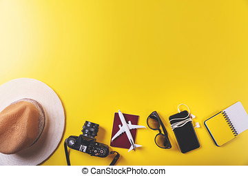 travel accessories on yellow background with copy space