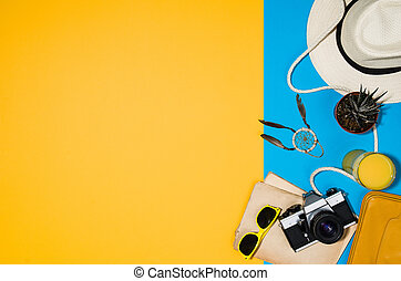 Travel accessories top view on colorful background with copy space