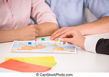 Travel agency - Family couple sitting at tourist agency and...
