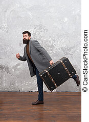 Travel and baggage concept. Hipster traveler with baggage. Ready for relocation with baggage. Start journey. On way to new life. Luggage insurance. Man well groomed bearded hipster with big suitcase