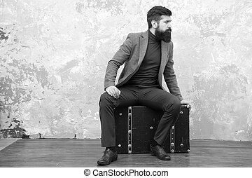 Travel and baggage concept. Hipster traveler with baggage. Ready for relocation with baggage. Start journey. On way to new life. Man well groomed bearded hipster big suitcase. Travel and relocation