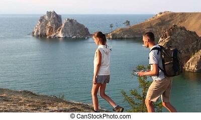 Travel and hiking couple looking at view. People on hike by...