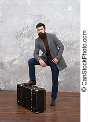 Travel and relocation. Man well groomed bearded hipster big suitcase. Travel and baggage concept. Hipster traveler with baggage. Ready for relocation with baggage. Start journey. On way to new life