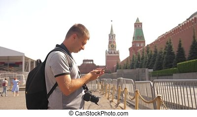 Travel and technology. Happy tourist man looks the navigator...