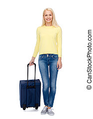 smiling young woman with suitcase