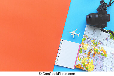 Travel background concept / Planning Essential vacation trip items in backpacks travel accessories with camera map and notebook for plane Traveler's