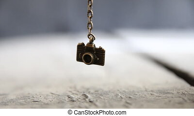 travel background - toy camera - Bronze toy Camera on a...