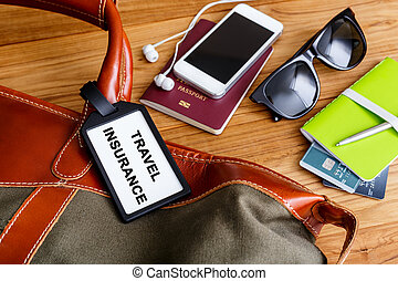 Travel bag with insurance tag and tourist accessories