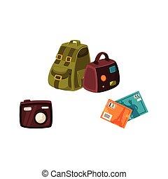 Travel bags, digital camera and travel postcards