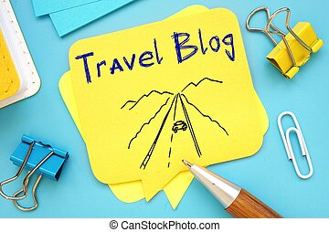 Travel Blog sign on the piece of paper.