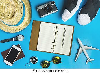Travel Blogger Accessories and fashion on blue background