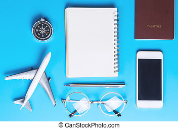 Travel Blogger writer accessories on blue background