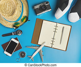 Travel Blogger writing accessories on blue background