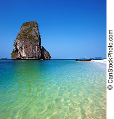 Travel boat on Thailand island beach. Tropical coast Asia landscape background