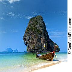 Travel boat on Thailand island beach. Tropical coast Asia...