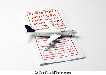 Travel brochure with a model airplane - Travel leaflet with...