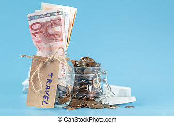 Travel budget concept. Travel money savings in a glass jar
