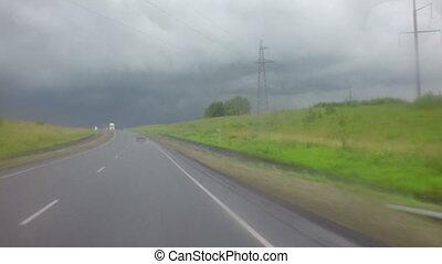 Travel by car in heavy rain on Altai Krai.