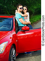 travel by car - Romantic couple in love embracing near the...
