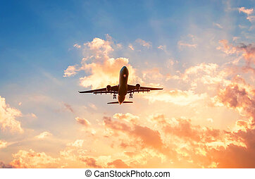 Travel by plane in a beautiful sky at sunset with clouds