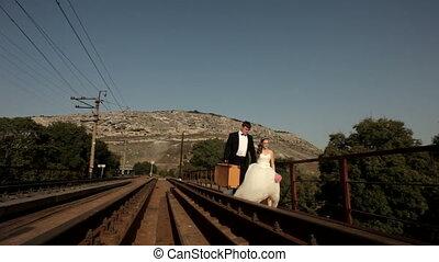 Travel by rail - Newlyweds go along the rail.